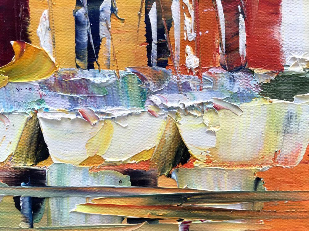 Palet schilderij kleurrijke huisjes aan zee close-up