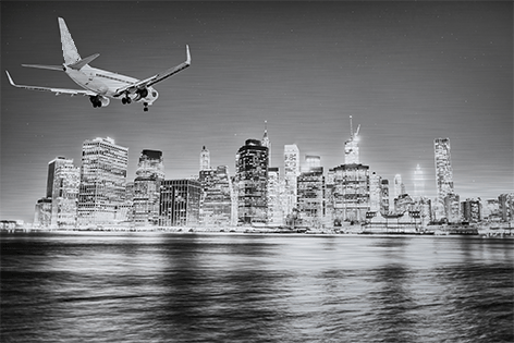 Airplane landing at NewYork airport by night