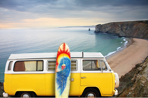 Yellow van with a surf board