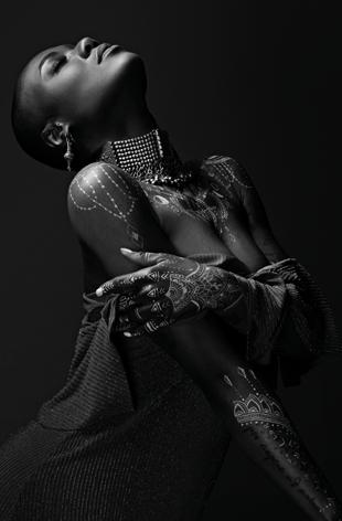 Dark woman with body art