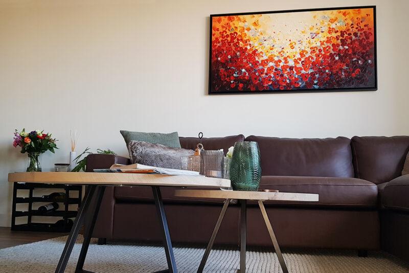 Schilderij 'Licht' brengt aangename kleuren in de woonkamer