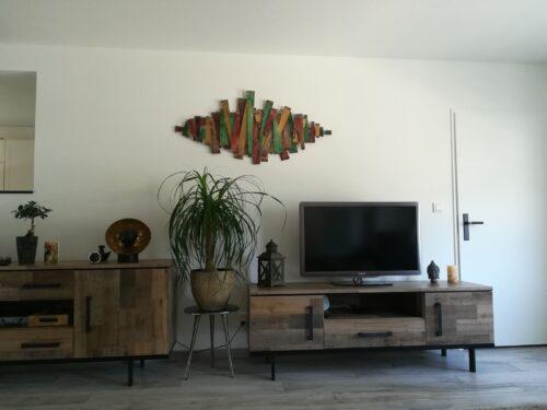 De staafjes dansen mooi op onze muur